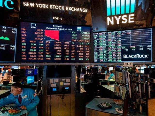 PHOTO: Traders work at the New York Stock Exchange on August 14, 2019, in New York.