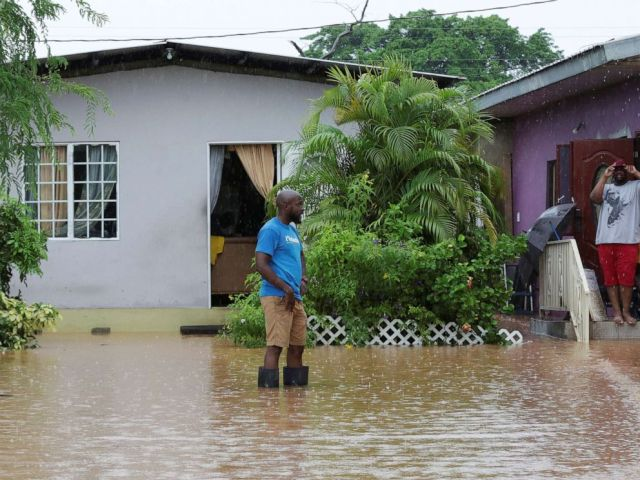PHOTO: A resident wades through an area flooded by a rain storm caused by Tropical Storm Karen in Barataria, Trinidad and Tobago, Sept. 22, 2019.
