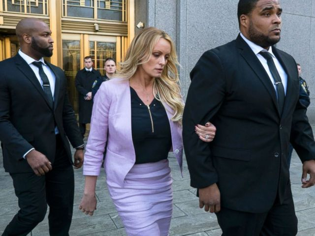PHOTO: Adult film actress Stormy Daniels leaves federal court after speaking to members of the media, April 16, 2018, in New York.