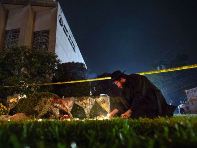 PHOTO: Rabbi Eli Wilansky lights a candle after a mass shooting at Tree of Life Synagogue in Pittsburgh, Oct. 27, 2018.