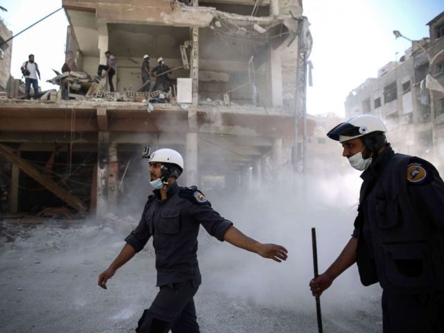 PHOTO: Syrian civil defense volunteers, known as the White Helmets, work around destroyed buildings following reported air strikes on the rebel-held town of Douma, on the eastern outskirts of the capital Damascus, Oct. 5, 2016.