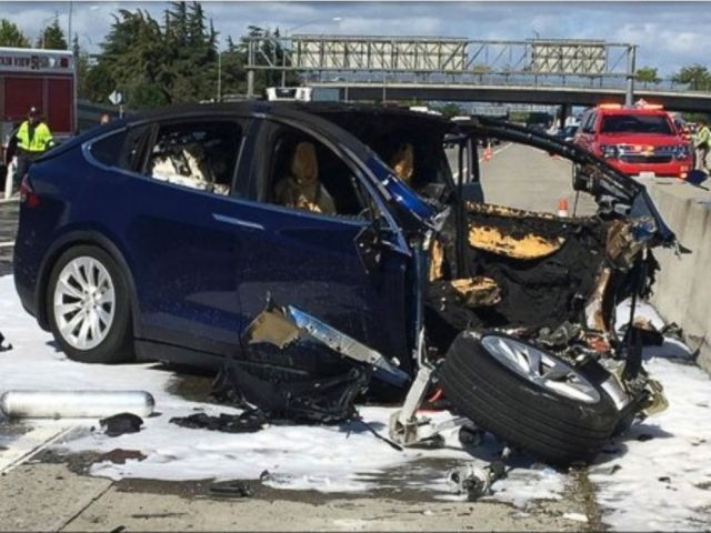On this Friday March 23, 2018 photo offered by KTVU, emergency personnel work a the scene where a Tesla electric SUV crashed staunch into a barrier on U.S. Twin carriageway a hundred and one in Mountain Witness, Calif.