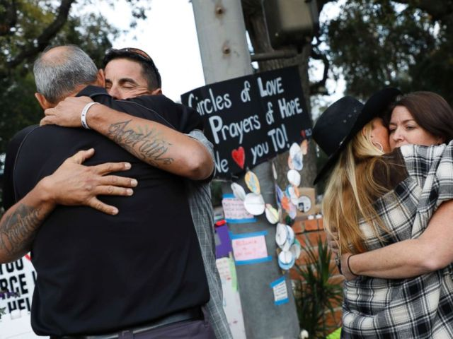 PHOTO: Jason Coffman, father of slain victim Cody Coffman, gets a hug at a vigil site for the shooting victims near the Borderline Bar and Grill, Nov. 7, 2018 in Thousand Oaks, Calif.