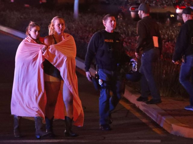 PHOTO: Two women wearing blankets leave the area near the Borderline Bar and Grill after a mass shooting in Thousand Oaks, Calif., Nov. 8, 2018.