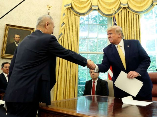 PHOTO: President Donald Trump shakes hands with Vice Premier Liu He in the Oval Office of the White House in Washington, Oct. 11, 2019.