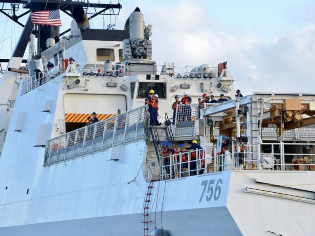 PHOTO: The crew of U.S. Coast Guard cutter Kimball await a passenger transfer just off Honolulu upon arrival Dec. 22, 2018.