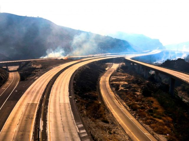 PHOTO: Freeway 5 and 14 are closed to traffic through Newhall Pass due to Saddle Ridge fire Oct. 11, 2019, in Newhall, Calif.