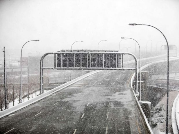 PHOTO: The road into Logan International Airport is empty as a winter storm bears down, March 13, 2018, in Boston.