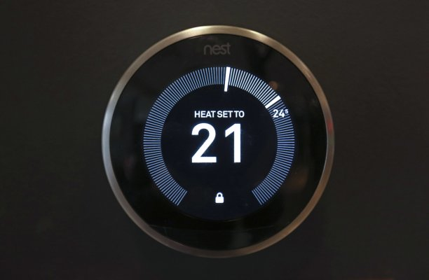 A Nest Labs Inc. digital wi-fi controlled thermostat sits on show in the Neat Home allotment of a John Lewis Plc department store in London, U.Okay., on Friday, April 8, 2016. The rising integration of connected units into our lives, what's frequently known as the Web of things or IoT, promises big advantages for consumers and companies. Photographer: Chris Ratcliffe/Bloomberg through Getty Photos