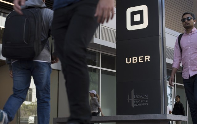 Pedestrians walk past the Uber Technologies Inc. headquarters building in San Francisco, California, U.S., on Wednesday, June 21, 2017. Travis Kalanickhas resigned from his job leadingUber Technologies Inc., giving up his effort to hold onto power as a torrent of self-inflicted scandals enveloped him and the global ride-hailing leviathan he co-founded. Photographer: David Paul Morris/Bloomberg via Getty Images