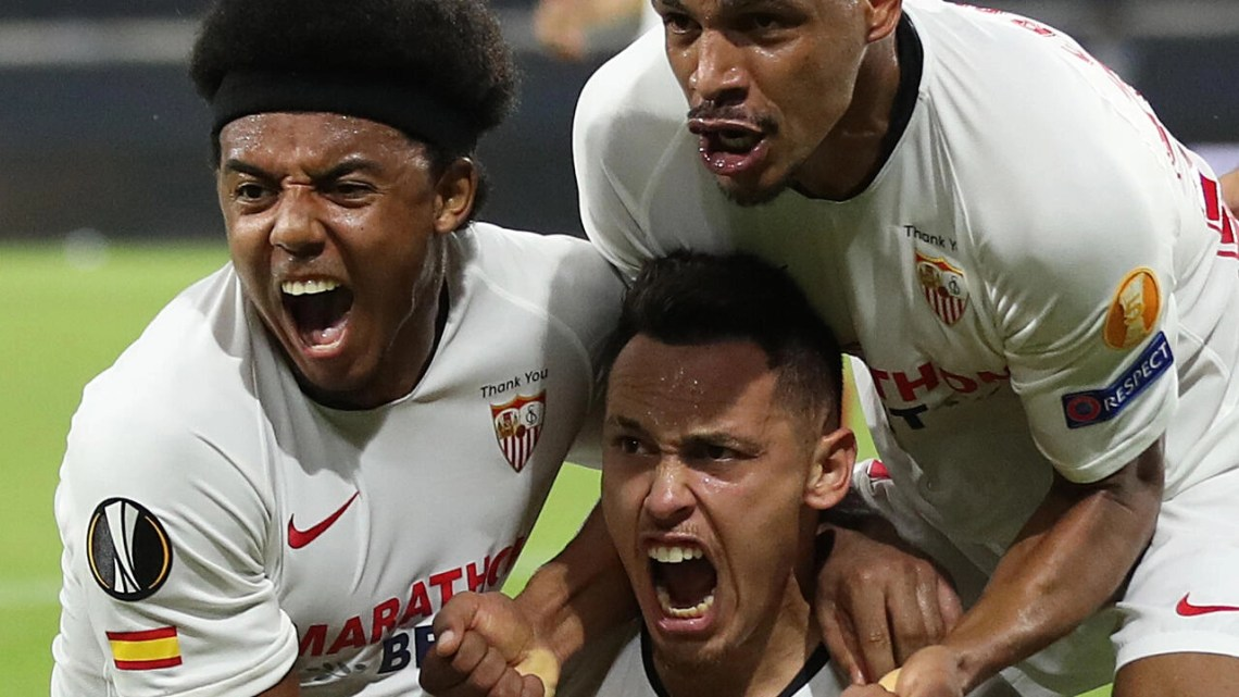Lucas Ocampos (C) sent Sevilla to the Europa League semi-final with a late header that saw off Wolves