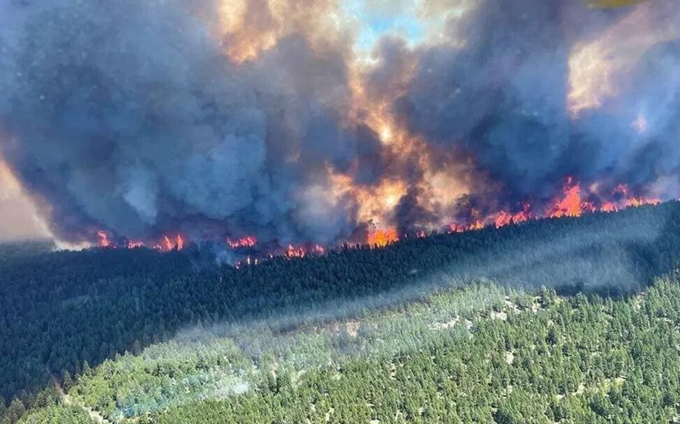 Wildfires near Sparks Lake, British Columbia, June 29, 2021. Dozens of fires from an unprecedented heat wave ravaged western Canada.
