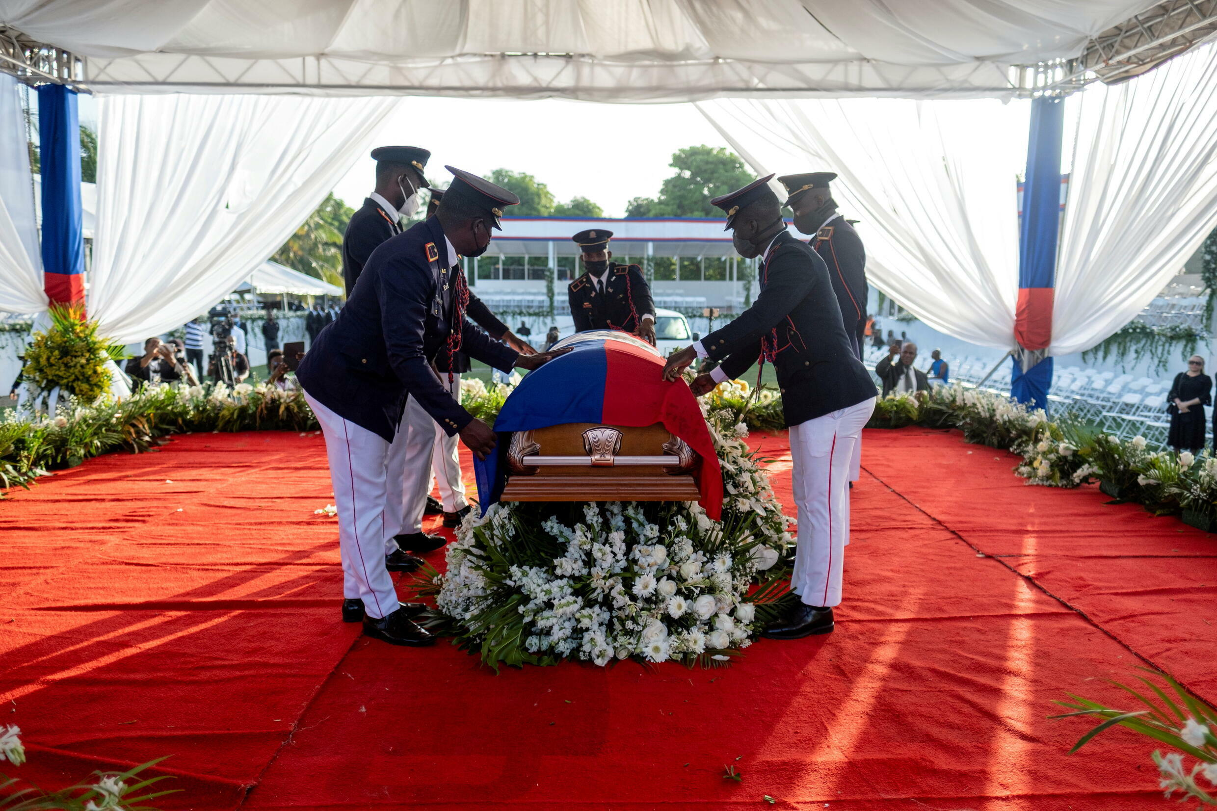 Presidential honor guards place a national flag on the coffin of the late Haitian President Jovenel Moise, Haiti, July 23, 2021.