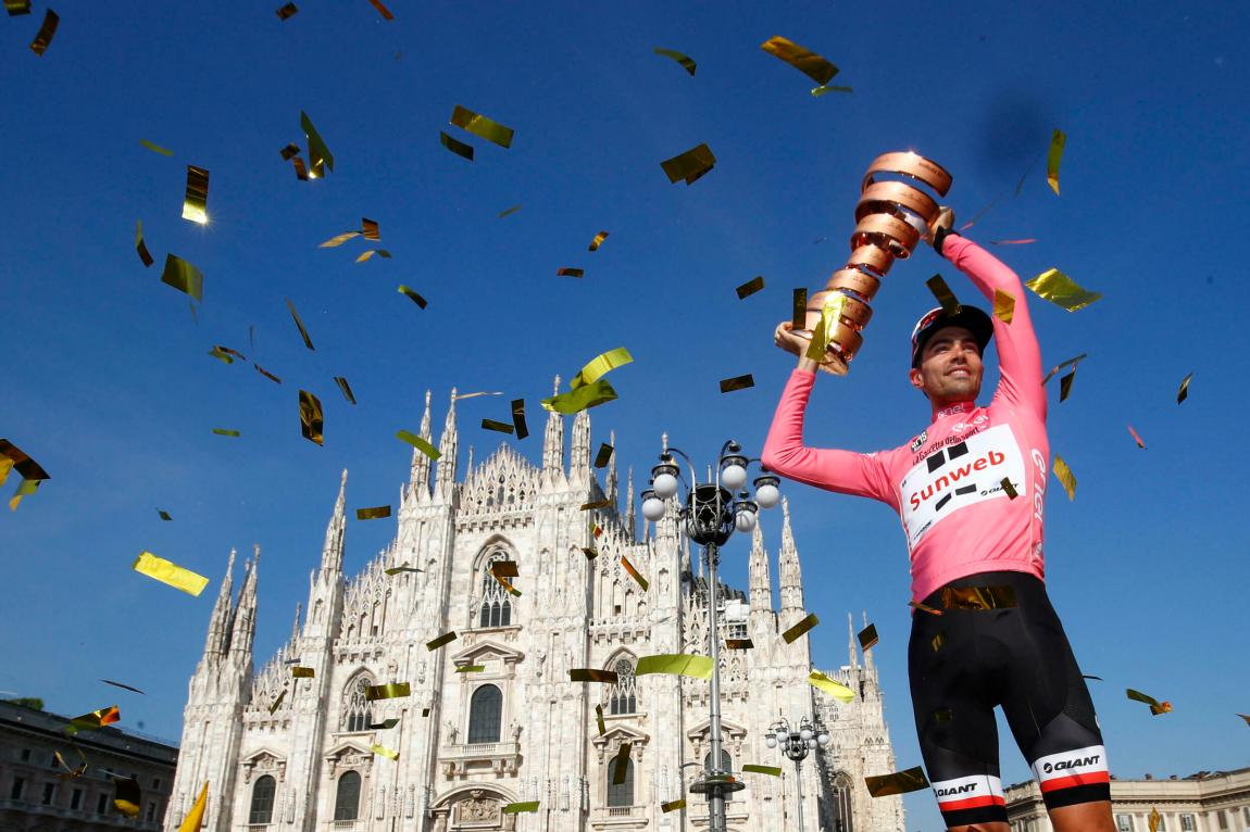 The winner of the 100th edition of the Giro d'Italia, the Dutch Tom Dumoulin of the Sunweb team, holds the trophy on the podium near Milan Cathedral after the last stage, an individual time trial between Monza and Milan, on May 28, 2017. Tom Dumoulin won the Giro 100 ahead of Colombian Nairo Quintana, from the Movistar team, second, and the Italian rider from the Bahrain - Mérida team, Vincenzo Nibali, third.