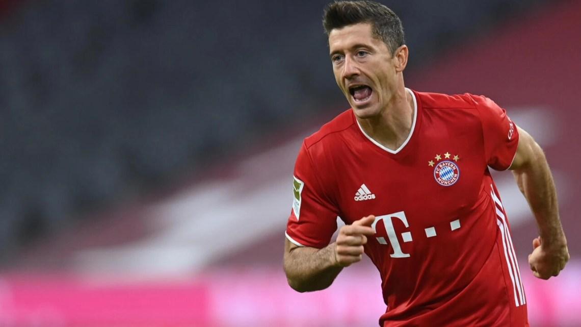 Bayern Munich striker Robert Lewandowski celebrates after scoring twice on Sunday
