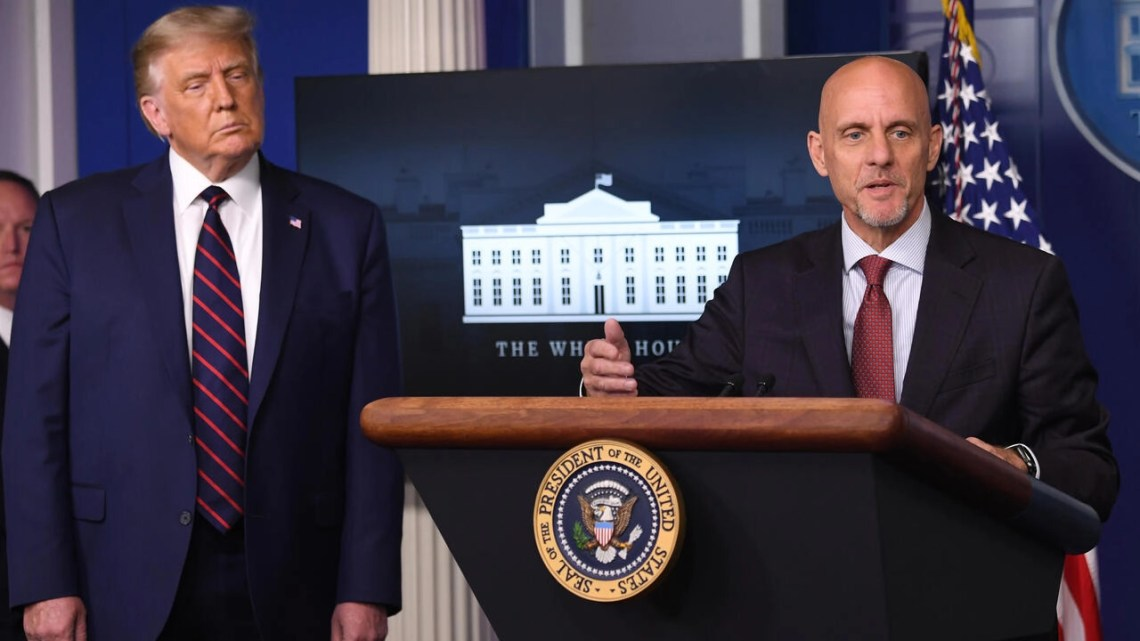 FDA Commissioner Stephen Hahn speaks as US President Donald Trump looks on during a press conference at the White House
