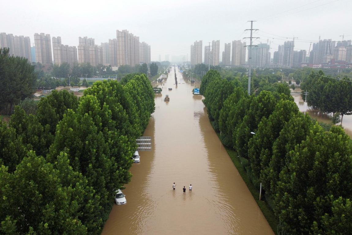 FILE: An aerial view shows a flooded road after heavy rains in Zhengzhou, Henan province, China, on July 23, 2021.