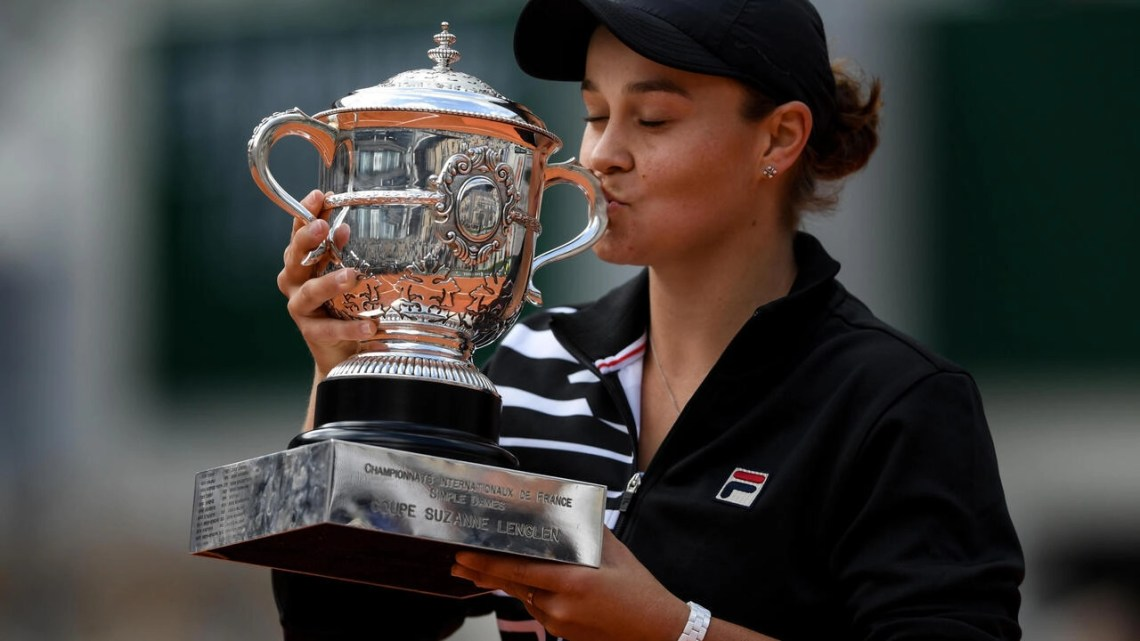 Australia's Ashleigh Barty kisses the Suzanne Lenglen trophy after winning the French Open last year