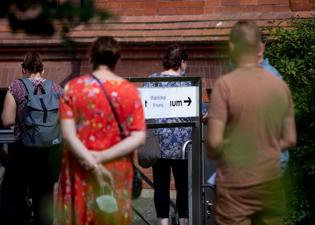 People wait in front of a polling station during the Saxony-Anhalt state elections in Wittenberg, Germany, on 06 June 2021.
