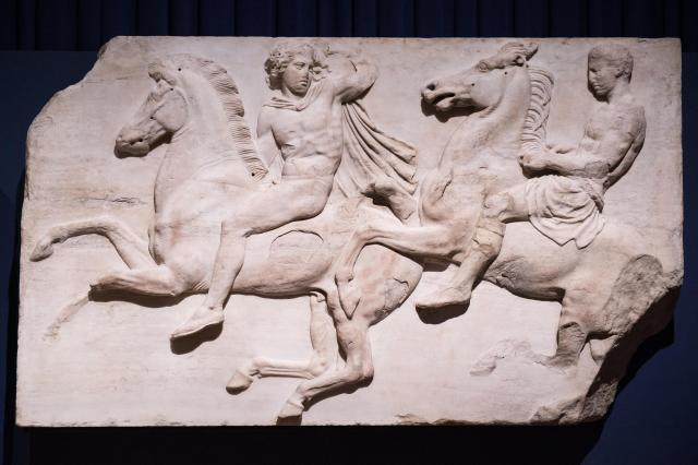 """Frieze sculptures from the Parthenon in Athens, part of the so-called """"Elgin Marbles"""" on display at the British Museum."""