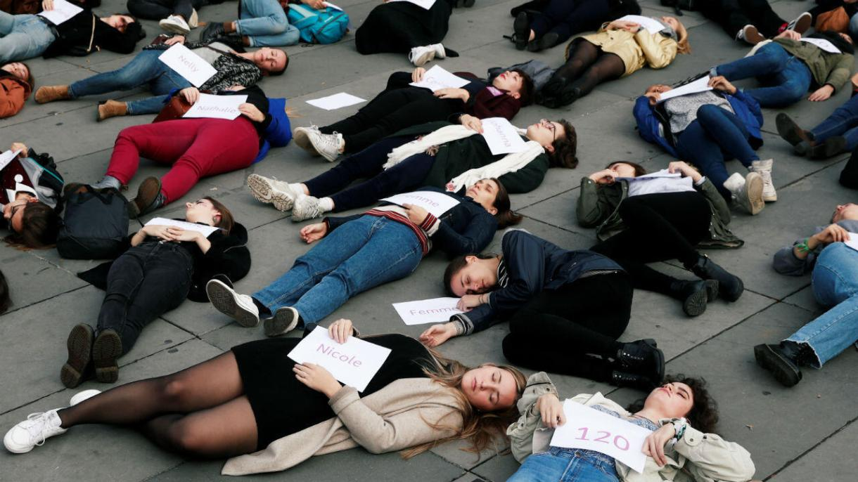 "Women stage a ""die-in"" in protest at violence against women in Paris on October 19, 2019."