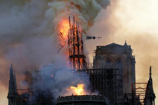 Fire engulfs the Gothic spire of Notre Dame Cathedral in Paris on April 15, 2019.