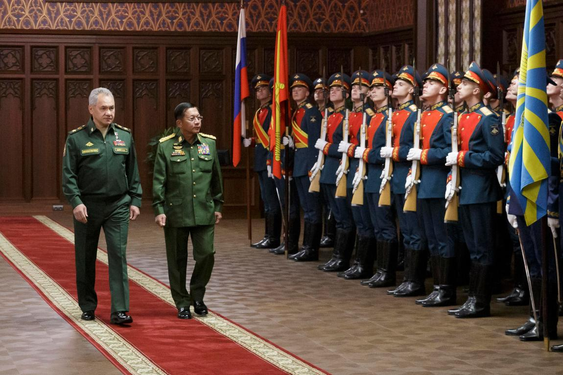 Russian Defense Minister Sergei Shoigu, left, and the Commander-in-Chief of Myanmar's armed forces, General-in-Chief Min Aung Hlaing, walk past the honor guard before their talks in Moscow, Russia, on the Tuesday, June 22, 2021.