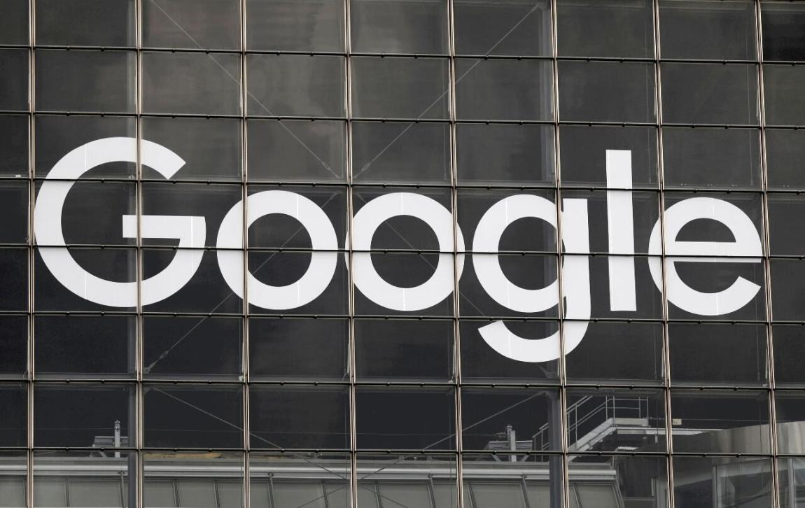 The Google logo is displayed on a building in the La Défense business and financial district in Courbevoie, near Paris, France, on September 1, 2020.