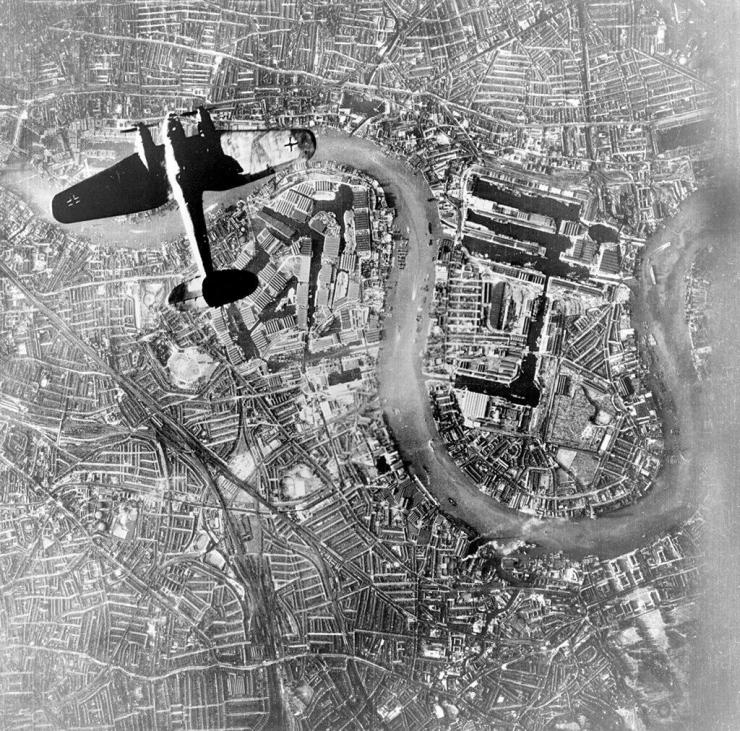 A German Luftwaffe Heinkel bomber flying over Wapping and the Isle of Dogs in the East End of London at the start of the Luftwaffe's raids on September 7, 1940.