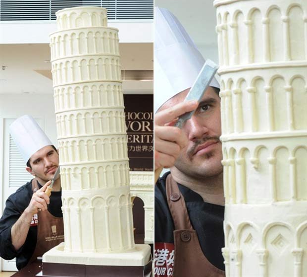Italiano trabalha em sua réplica da Torre de Pizza. Sweet Amado