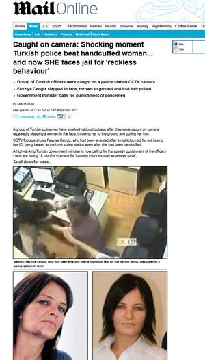 Mesmo algemada, mulher sofreu agressões na delegacia e ficou com hematomas (Foto: Reprodução/Daily Mail)