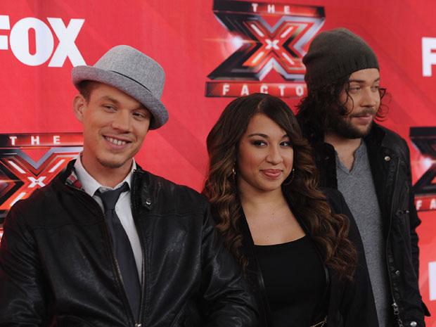 Chris Rene, Melanie Amaro e Josh Krajcik, finalistas do programa 'X-Factor' (Foto: Mark Davis/AFP)