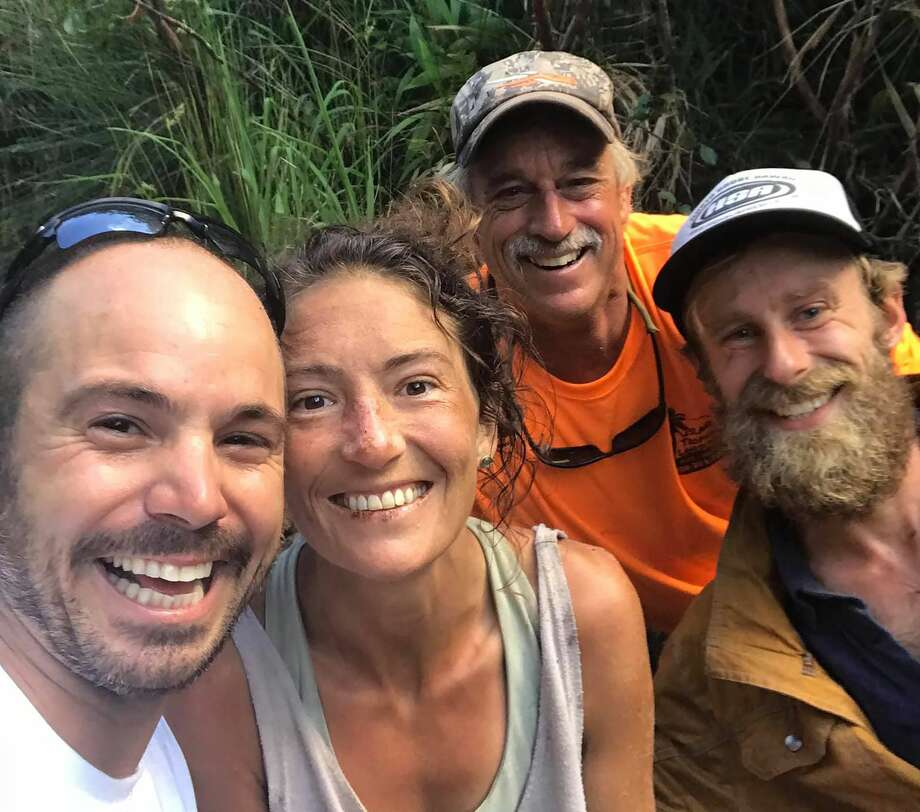 =In this image courtesy of Javier Cantellops and obtained at facebook.com/AmandaEllersMissing, shows missing hiker Amanda Eller (2nd L) with her rescuers, (L-R) Javier Cantellops, Troy Helmer and Chris Berquist, on May 24, 2019, at Makawao Forest Reserve on the Hawaiian Island of Maui. Eller, 35, was reported missing on May 8, prompting a massive search. (Photo by Javier CANTELLOPS / facebook.com/AmandaEllersMissing/AFP). Photo: JAVIER CANTELLOPS/AFP/Getty Images