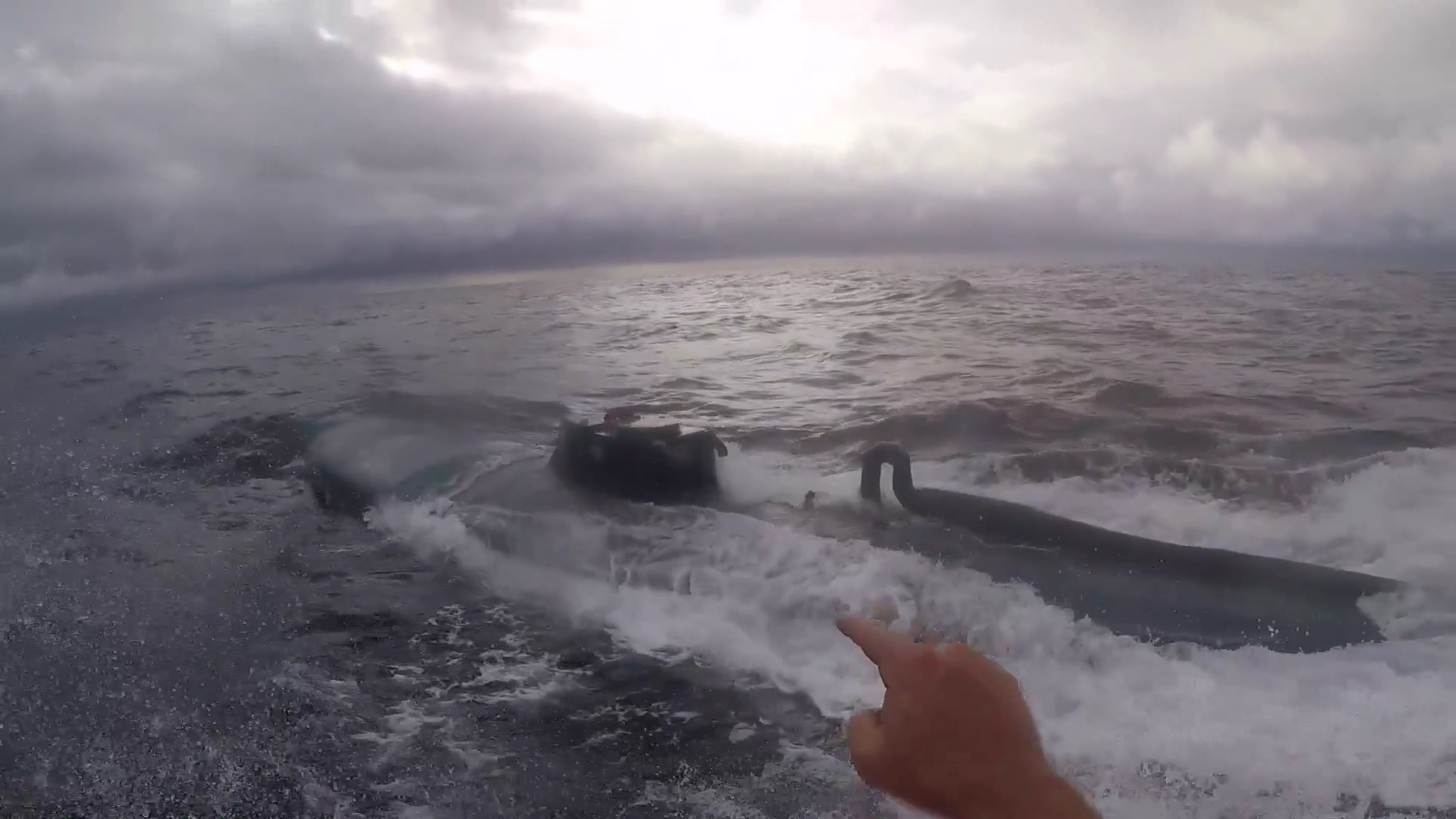 watch coast guardsman leap onto moving submarine in pacific