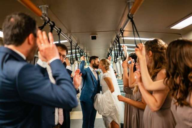 Laura Hansen and Jeremy Bachrach surrounded by their bridal party on a BART car on their July 13 wedding. The couple opted for public transit for their special day over a limousine or party bus. Photo: Russell Edwards, Russ Levi Photography/russlevi.com/@russlevi On Instagram
