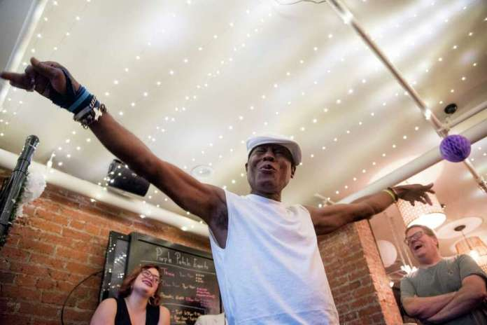 Tio Brown, a regular at Purple Patch restaurant's open piano nights, sings on July 17. The weekly piano gatherings have become a community attraction. Photo: Washington Post Photo By Marlena Sloss / The Washington Post