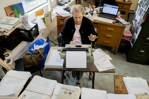 Barbara Cetko, 93, legal section editor at the long-running Martinez News-Gazette, works on her copy.