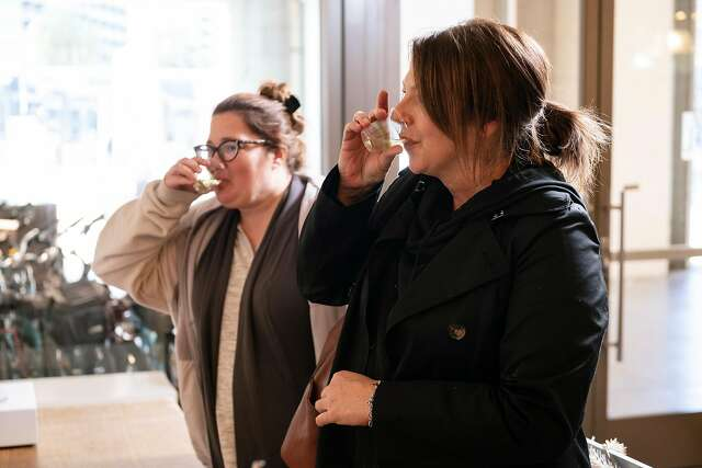 Catherine Brown (left) and Lori Liston try honey wine during a tasting at Bee D'Vine in the Ferry Building.
