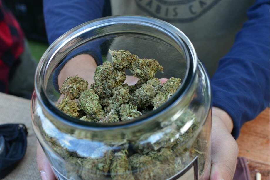 A jar of hemp called Special Sauce from Lowell Herb Co., smoking hemp flower in the smoking lounge at the CBD Saturday Market. (Image Credit: Lindsey Bartlett/Green Entrepreneur) Photo: Lindsey Bartlett