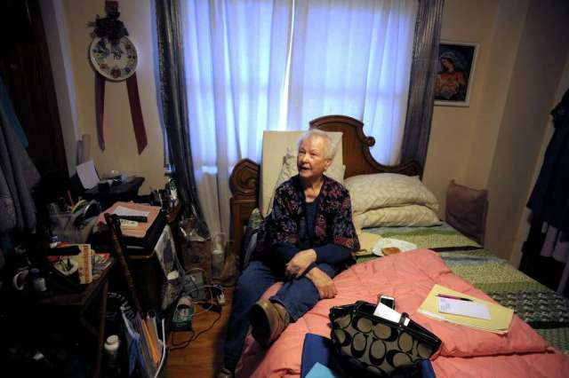 <p>Maria Michaels speaks during an interview in the bedroom where she spends most of her time in her home in Stratford, Conn. Jan. 17, 2020. Michaels, 87, is appealing a recent eviction order to vacate the home</p>
