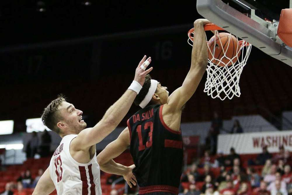Stanford forward Oscar da Silva, right, dunks in front of Washington State forward Jeff Pollard during the first half of an NCAA college basketball game in Pullman, Wash., Sunday, Feb. 23, 2020. (AP Photo/Young Kwak)
