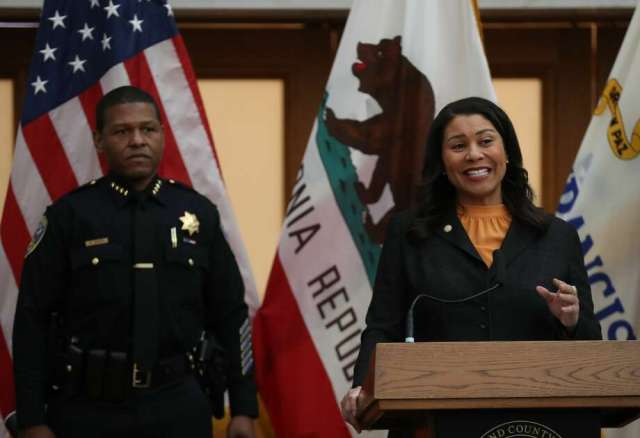 FILE: San Francisco Mayor London Breed (R) speaks during a press conference as San Francisco police chief William Scott (L) looks on at San Francisco City Hall on March 16, 2020. Photo: Justin Sullivan/Getty Images / 2020 Getty Images