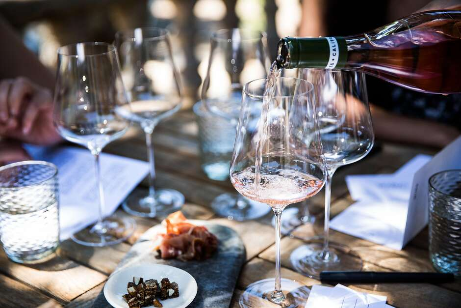 Wine is poured during a tasting at Reeve Winery in Healdsburg, California on June 29, 2017.