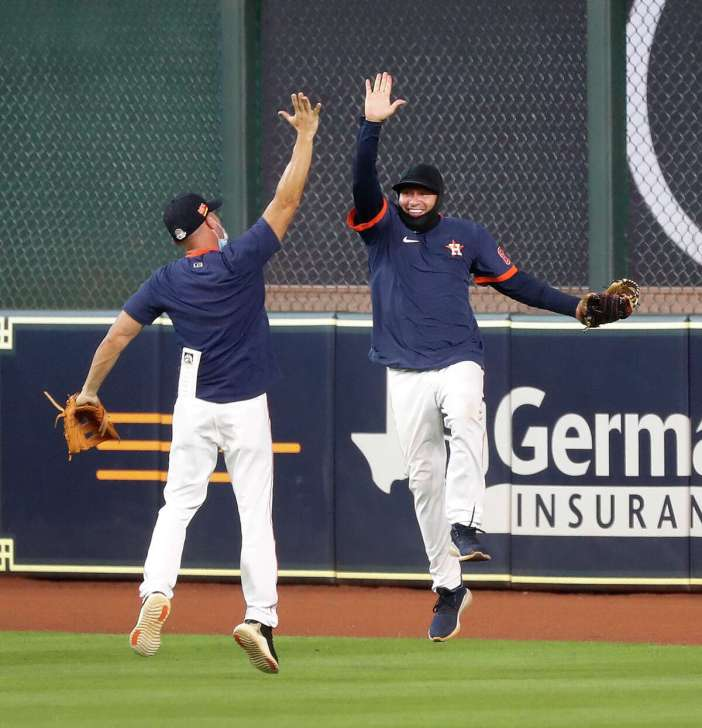 Houston Astros bullpen catcher Javier Bracamonte playing in center field celebrates after robbing Alex Bregman of a double to end the Houston Astros intrasquad game during the Astros summer camp at Minute Maid Park, Thursday, July 9, 2020, in Houston.