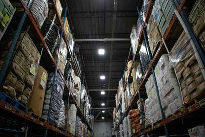 Produce is stored in a refrigerated section of the Houston Food Bank on Thursday, July 9, 2020.