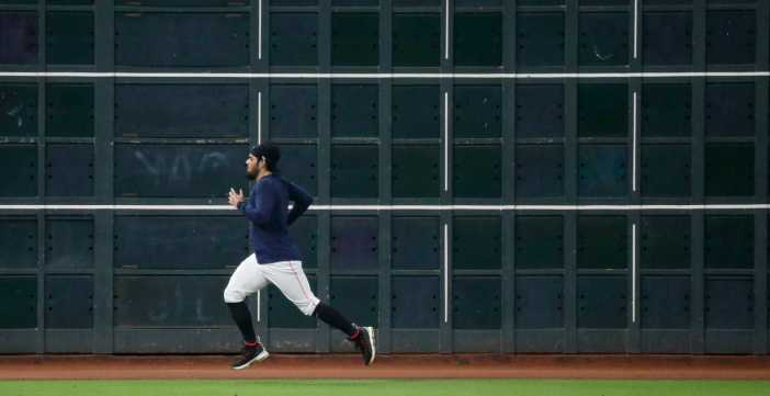 Houston Astros pitcher Roberto Osuna runs sprints in the outfield during the Astros summer camp at Minute Maid Park, Friday, July 17, 2020, in Houston.