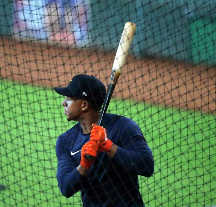 Houston Astros outfielder Michael Brantley bats in the cage during the Astros summer camp at Minute Maid Park, Friday, July 17, 2020, in Houston.