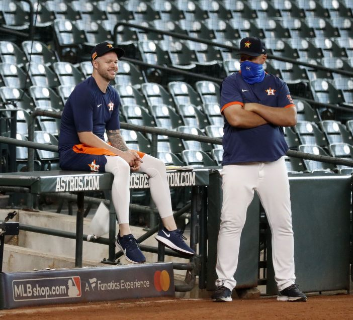 Houston Astros pitcher Ryan Pressly chats with pitching coach Brent Strom during an intrasquad game at the Astros summer camp at Minute Maid Park, Friday, July 17, 2020, in Houston.