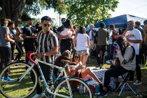 A young crowd attends the Juneteenth celebration at Lake Merritt in Oakland. Young people make up thefastest-growing demographic contracting the coronavirus in many regions.