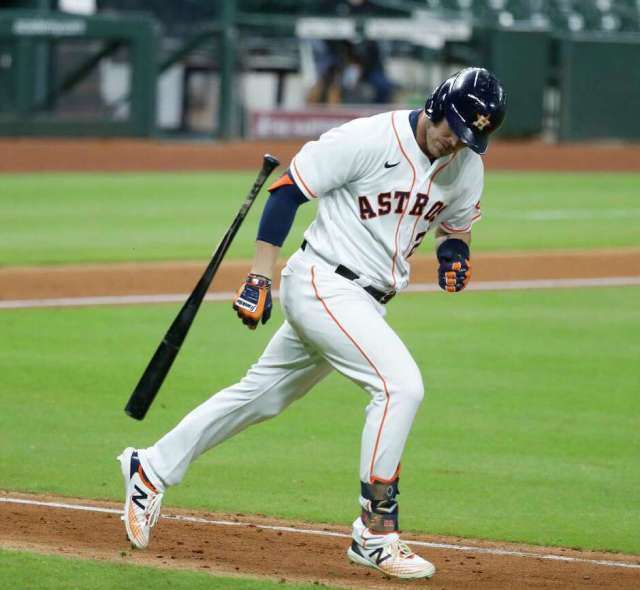 Houston Astros Josh Reddick throws his bat in frustration as he popped out to Los Angeles Dodgers shortstop Corey Seager during the sixth inning of an MLB baseball game at Minute Maid Park, Wednesday, July 29, 2020, in Houston.